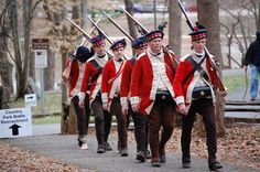 Members of the 71st Regiment of Foot march victorious from the field of battle at the 229th Anniversary Re-Enactment of the Battle of Guilford Court House.