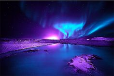 Auroras. Purple and blue northern lights. Auroras reflections.