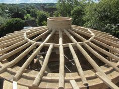 Roundwood timber framed strawbale roundhouse roof built by Ditchfield Crafts