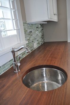 Hammered polished nickel sink with gorgeous wood counter tops!