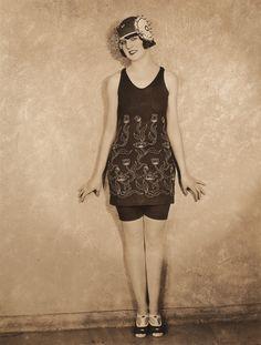 (1925) My grandmother in high fashion swimming gear. The bathing cap looks like it may not be waterproof.  #HENDRICKSLADYHATS