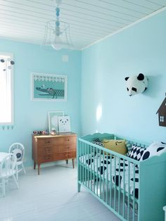A cool minty blue/green nursery for a little boy or girl