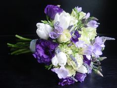 sweet purple & lavender wildflower bouquet-perfect for early spring weddings - This is beautiful...unfortunately it says good for spring, which may mean it would be more expensive in July. :P