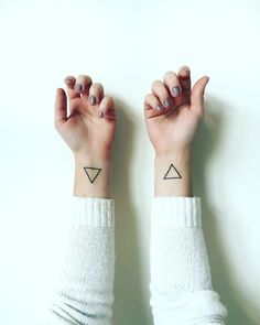 minimalist equilateral open triangle tattoo on wrists