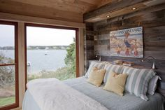 Love the art and the natural calming colors in this Nantucket beach cottage bedroom.  Now for a stack of books....