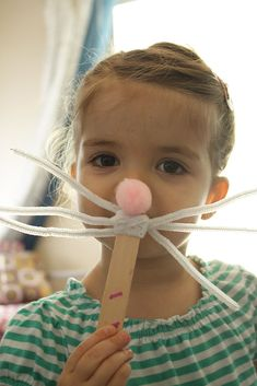 Large popsicle sticks, white pipe cleaners, and pink fluffy pom poms are the only three items needed to recreate Kailo Chic's cute bunny mask. Source: Kailo Chic