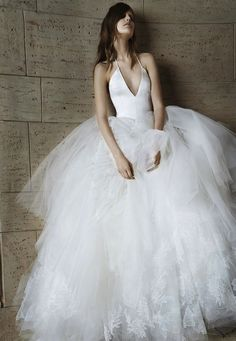 plunging halter neck and romantic tulle skirt. Big fun dress