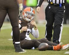 Cleveland Browns quarterback Johnny Manziel (2) reacts after being sacked by Cincinnati Bengals defensive tackle Geno Atkins in the third quarter of an NFL football game Sunday in Cleveland.