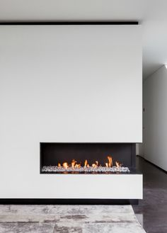 Minimal and clean interior design, modern open fireplace by Metalfire _