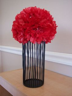 Tissue paper poms are a lot easier to make than they look! Love this idea!