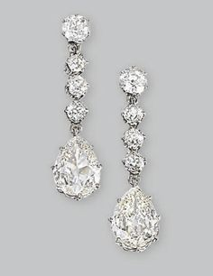 A PAIR OF DIAMOND EAR PENDANTS  Each set with a pear-shaped diamond weighing 1.68 and 1.35 carats to the four-stone old-cut diamond surmount