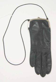 Take an old leather glove, or long gloves, and sew a zipper across the top and part way down the side. Attach a shoulder strap. myb