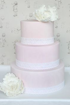 Pink with white lace cake