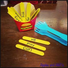 """French Fry Sight Word Game. Each child gets a french fry container. The sight word """"fries"""" (painted popsicle sticks) are placed on the table. Children take turns reading the sight words on the """"fries"""", collecting the ones read correctly and placing them in their container. Could get kids to write the words from their containers after the game is finished. Fry Words, Fry Sight Words, Teaching Sight Words, Sight Word Practice, Sight Word Games, Sight Word Activities, Phonics Activities, Literacy Activities, Educational Activities"""