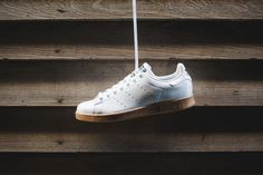 As if the OG Running White/Fairway colorway weren't clean enough, adidas Originals comes correct with a White/Gum edition of the timeless tennis classic that is the Stan Smith. Donning a stark white l...