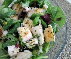 Flaked lemony baked basa fish over salad greens. Healthy and delish.