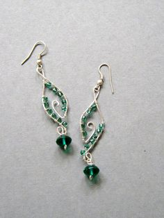 Handmade wire wrapped earrings, Green Dangles, handmade jewelry. $29.50, via Etsy.