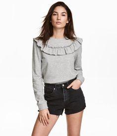 Gray melange. Soft sweatshirt with a ruffle at top and ribbing at neckline, cuffs, and hem.