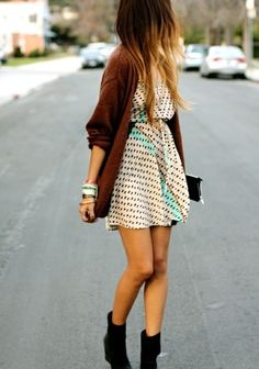 Boots, bare legs, long brown cardi...