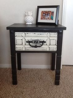 Vintage side table refinished with black chalk paint white distressed drawer and original hardware. https://www.facebook.com/bluelotusfurniture