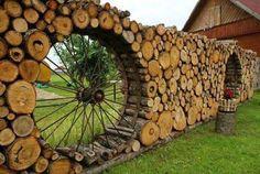 Log fence/wall with wagon wheel windows.
