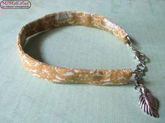 Stoffarmband in gold/weiß & silbernem Blatt