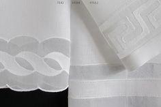 Toalhas de mão em linho e organdy bordadas com ponto francês e caseado.