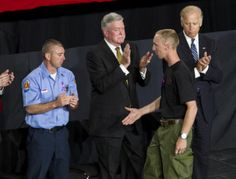 Brendan McDonough reaches his hand out to Dan Bates (left), vice president of the United Yavapai Fire Fighters, Prescott chapter, during a memorial service.