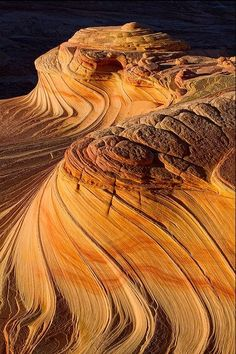 "The Wave--Photo by Justin Reznick - the Coyote Buttes North region of the Arizona / Utah border. You need a permit to get to ""The Wave"". It is extremely competitive and it's a great idea to put in for an online permit 4 months in advance."