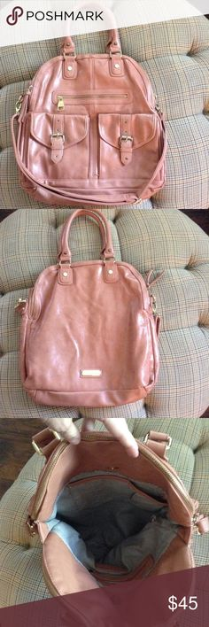 Salmon STEVE MADDEN Very Large Satchel Nice Preowned condition.  Tons of storage. Three large storage areas, two front pockets, one front zip pocket. Removable strap. No issues. Very large Steve Madden Bags Hobos
