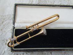 Rhinestone trombone brooch by Nkempantiques on Etsy