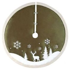 """Gather family and friends with this wintry tree skirt, featuring a stag silhouette against a background of evergreens and snowflakes.  Product: Tree skirtConstruction Material: FabricColor: Olive and whiteDimensions: 54"""" Diameter"""