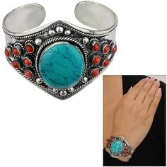 Dispersed throughout this silver plated cuff are bursts of red beads, accentuating the bold, turquoise center stone. This Tibetan cuff adds international flare to your wardrobe!