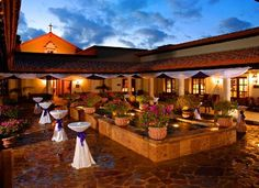 Pueblo Bonito Sunset Beach--courtyard event.jpg (396×287) cocktail tables, courtyard wishing well, potted plants