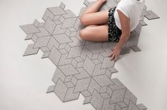 Cityscapes Colors — ALLT.  VERY cool!  Cityscapes is a tiled carpet which derives its isometric form from complex city views and uses a simple grey woolen felt as the material of choice. You can rearrange the tiles into various shapes and create symmetrical geometry as well as asymmetrical islands that bear resemblance to architectural building kit.