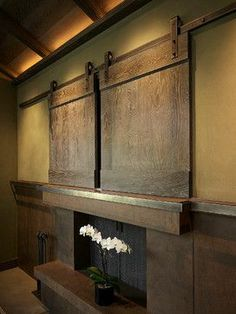 images tv over fireplace | Tv Above Fireplace with sliding barn doors to hide it. | Decor