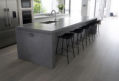 A Seamless 4.4m concrete Island bench by SLABS by Design