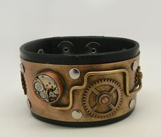 Awesome steampunk bracelet. I riveted gears into textured brass and then riveted it to 1 3/4 wide leather band. I patina the metal to give it an antique
