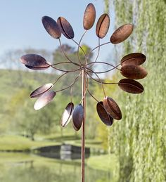 Kinetic Spinner  http://www.windandweather.com/Best-Selling-Yard-and-Patio/Dancing-Leaves-Iron-Wind-Spinner.htm