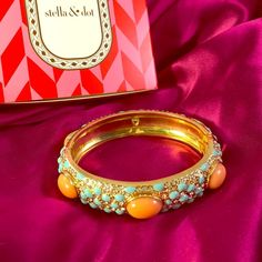 Stella & Dot Sunset Bangle Pre loved. Coral and turquoise beads on a gold spring hinge bracelet encrusted with about 100 rhinestones. In great condition. Comes with S+D box. Missing a turq bead and a rhinestone-see photo 4. Not noticeable when wearing. Stella & Dot Jewelry Bracelets