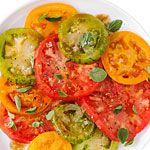 38 Fresh tomato recipes: Heirloom Tomato Salad with Pomegranate Drizzle (shown)