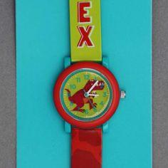 Montre enfant dinosaure T-Rex Crocodile Creek sans phtalates.  Une première montre gaie, colorée et illustrée d'un dinosaure T-Rex pour apprendre à lire l'heure et arriver à l'heure à l'école ! Les parents apprécieront... Bracelet garanti sans phtalates. Motifs : dinosaure T-Rex. Diamètre du cadran : 29 mm. Boitier en acier inoxydable. Pile fournie. Idée cadeau. http://www.lilooka.com/fr/montres-enfants-crocodile-creek/929-montre-enfant-dinosaure-t-rex-crocodile-creek-sans-phtalates.html