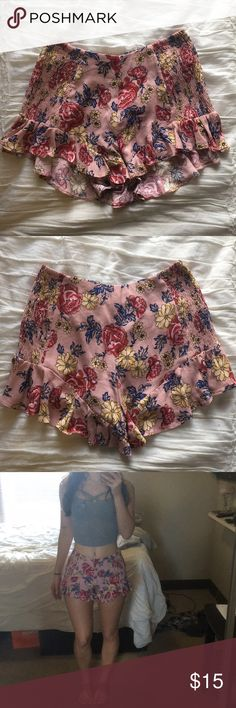Cute floral flowy shorts! Like new! Light pink, floral, ruffled shorts! Lightweight and bright, great for spring and summer. Only been worn a handful of time and they show absolutely no signs of wear. Very comfortable and breathable if you live in a hot climate like I do! Super cute for a casual outfit or dress them up a little with wedges and accessories! American Rag Shorts