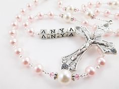 Pink and White Swarovski Pearl Personalized Rosary Beads - Baptism, First Communion, Confirmation Catholic Gift for a Girl by RosaryGardenCathy on Etsy https://www.etsy.com/listing/100564723/pink-and-white-swarovski-pearl