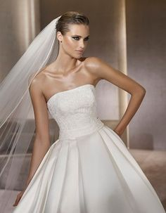 Pronovias Glamour Collection Piccola. Satin ballgown with embroidered bodice. This looks like my favorite PoB Jewel gown, minus the big bow in the back.