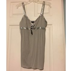 Express Sequin Tunic Tank Love this tank, but sadly a bit too tight for my chest! Pretty silver gray with sequin embellishment. Longer length tank. This is a true Medium. Brand new! Express  Tops Tank Tops