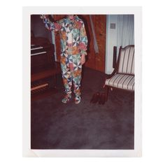 Vintage Snapshot | Collection of Guy Saunders #snapshot #vintagephotos #foundphotograph #unknownphotographer #amateur #vernacular #composition #1980s #headless #polaroid #harlequin #outfit #homemade #onesie #electricorgan #vintagesnapshot