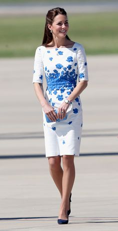 Kate was lovely in blue and white at the Royal Australian Airforce Base.Wearing: LK Bennett dress,Oroton clutch via StyleList