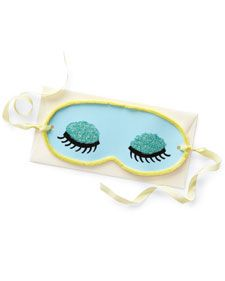 Pamper Mom this Mother's Day with a homemade dreamy sleep mask. Print the sleep-mask clip art onto card stock. Write a message on the back, and decorate if desired (we used glitter on the eyelids and pipe cleaners around the border). Punch a hole in each side, and thread with ribbon ties.