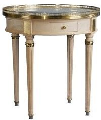 Champagne Side Table Brass detail surrounds this beautiful handmade marble top table with traditional lines.